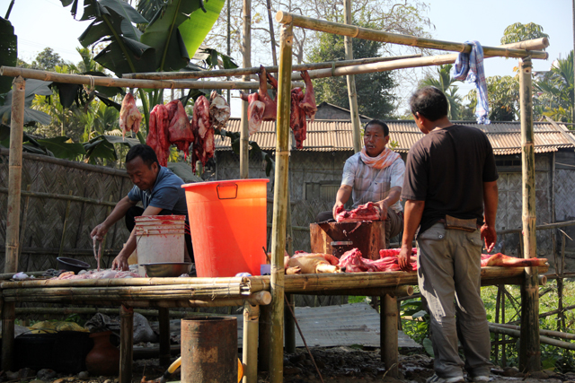 Butchering pigs in Nagaland