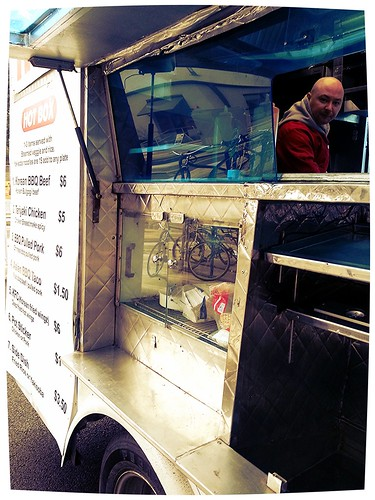 A Portland food cart, Hot Box Asian Grill, with its owner