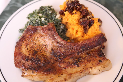 Pan Roatsed Pork Chop with Candied Pecan Sweet Potatoes, and Garlic Creamed Kale