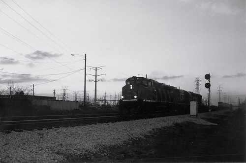 Southbound Grand Trunk Western Railroad freight train passing through Hayford junction at twilight.  Chicago Illinois.  may 1989. by Eddie from Chicago