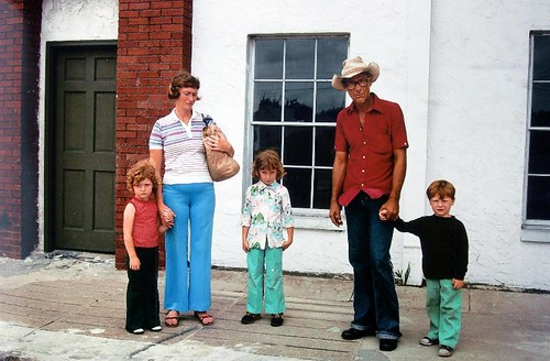 Ybor City, Florida (Mother with Brown Paper Bag), 1983, by Mitch Epstein