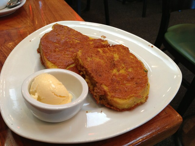Plate with two thick slices of French toast and a bit scoop of vegan butter.