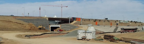 Photo of Triple Stack Underpass for commuter rail tracks to go under Jeppesen Terminal roadway crossover