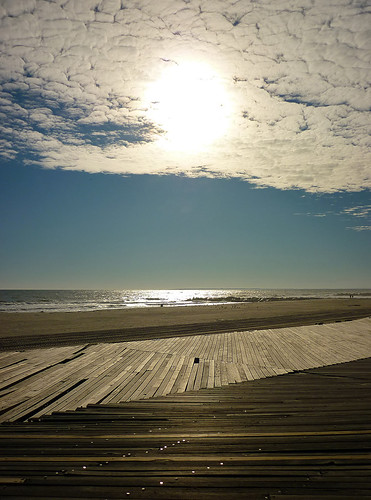 ocean blue light sunset sea sky people sun ny newyork beach water clouds skyscape walking sand shoreline relief queens disaster boardwalk atlanticocean rockaway farrockaway rockawaybeach averne hurricanesandy beach74thstreet