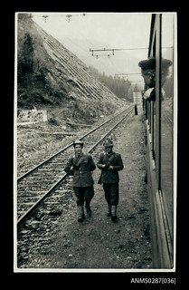 Border guards beside a train on the Italian border
