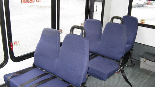 Right side interior seats folded down aboard a Ford paratransit mini bus. by Eddie from Chicago