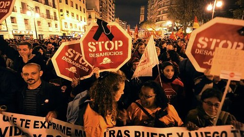 Spanish citizens demonstrate for a moratorium on foreclosures. The European state has been one of the hardest hit by the world capitalist crisis. by Pan-African News Wire File Photos