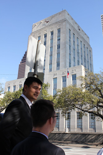 February 15th, 2013 - Yao Ming walks along the streets of downtown Houston and stops at City Hall