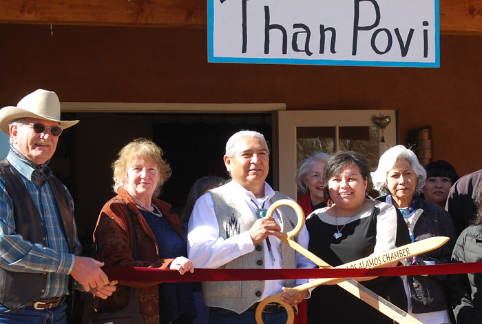 Elmer Torres (middle), shown here during the grand opening of his Than Povi Fine Art Gallery in Cuyamungue, is one of last year's Native American Venture Acceleration Fund recipients.