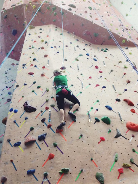 Roommate rock climbing
