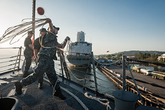 Logistics Specialist Seaman Christopher Allen throws a line to the pier as USS Stockdale (DDG 106) arrives at Subic Bay, Feb. 5, for a routine port visit. (U.S. Navy photo by Mass Communication Specialist 2nd Class David Hooper)