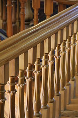 carillon(0.0), organ pipe(0.0), musical instrument(0.0), pipe organ(0.0), baluster(1.0), wood(1.0), handrail(1.0), molding(1.0), interior design(1.0), hardwood(1.0), stairs(1.0), column(1.0),