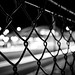 Fence at a train station by Terence l.s.m