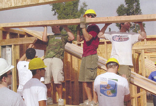 Pomona-Pitzer football players help out during a five-college Habitat for Humanity volunteer weekend in fall 2005
