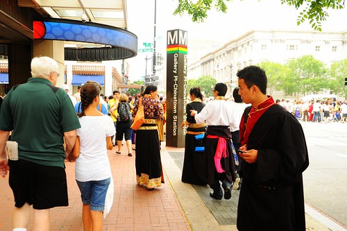 Tibetan people at Kalachakra on the streets of Washington D.C. wearing formal chubas, Seventh street NW, Chinatown, USA by Wonderlane