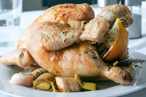 aromatic roast chicken with herbs, garlic lemon and wine