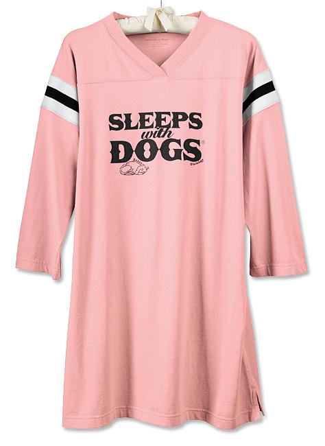 sleeps with dogs
