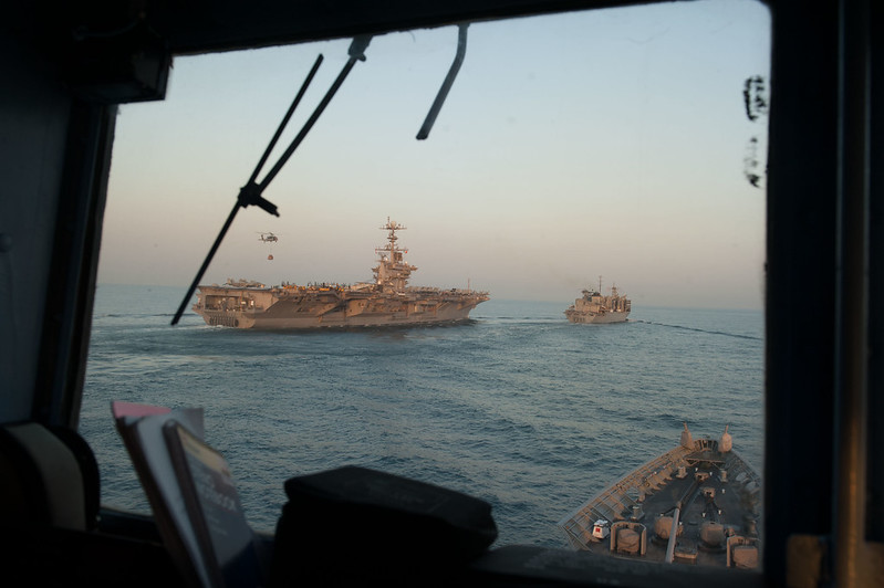 USS Mobile Bay, bottom, prepares to move alongside the USNS Bridge, right, USS John C. Stennis during a replenishment-at-sea