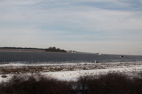 Field of solar panels in a snow covered Germany