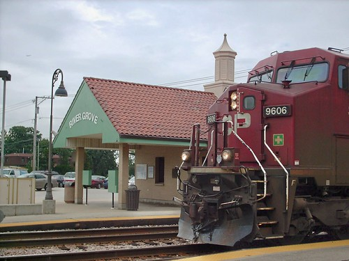 A westbound Canadian Pacific freight train passing through the River Grove Metra commuter rail station.  River Grove Illinois.  August 2007. by Eddie from Chicago
