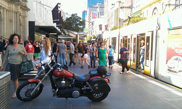 Is it permitted to park motorbikes in tram stops in the Mall? Not legal to drive it into Mall. Rego 1C9PW.