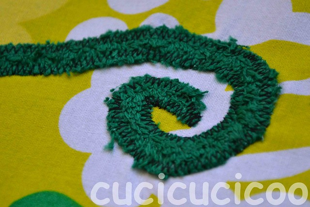 finished spiral appliqué on swimming pool locker room foot mats