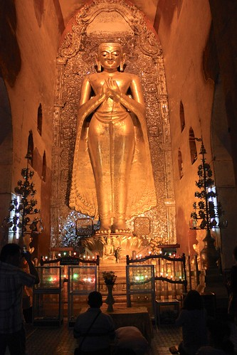 A giant gold Buddha in a temple