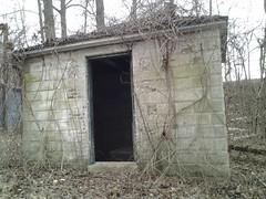 bunker(0.0), ruins(0.0), air-raid shelter(0.0), chapel(0.0), building(1.0), shack(1.0),