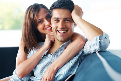 Beautiful young couple relaxing on couch