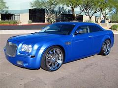 chrysler 300(0.0), automobile(1.0), automotive exterior(1.0), executive car(1.0), wheel(1.0), vehicle(1.0), automotive design(1.0), rim(1.0), chrysler(1.0), bumper(1.0), sedan(1.0), land vehicle(1.0), luxury vehicle(1.0),