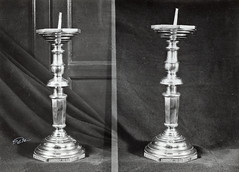 baluster(0.0), column(0.0), lighting(0.0), metal(1.0), monochrome photography(1.0), candle holder(1.0), silver(1.0), black-and-white(1.0),
