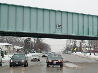 Railroad viaduct bridge with an old 1971 Norfolk & Western logo.  Worth Illinois.  January 2007. by Eddie from Chicago