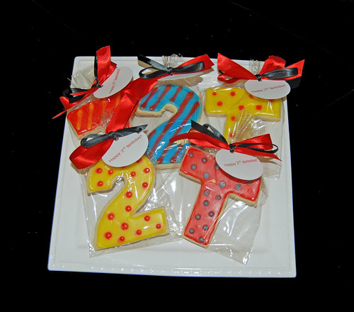 Bright colored monogram and number cookie favors for a 2nd birthday