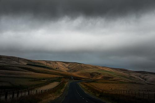 road clouds rural dark nz otago mahinerangi