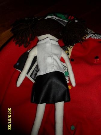muñeca por la espalda