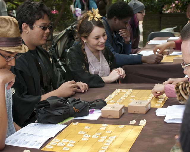 Visitors play shogi with the NY Shogi Club at Puzzle Plaza. Photo by Mike Ratliff.