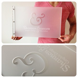 Custom graphic design portfolio book- Frsoted clear acrylic with engraving and cut-out treatments