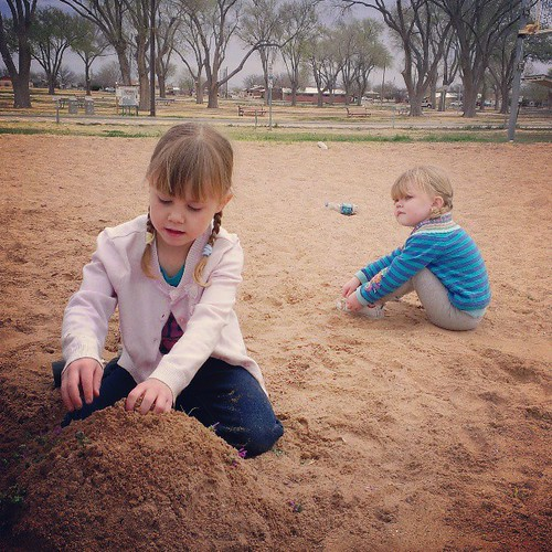 Sand play. Who needs buckets and shovels when you have sticks and water bottles.
