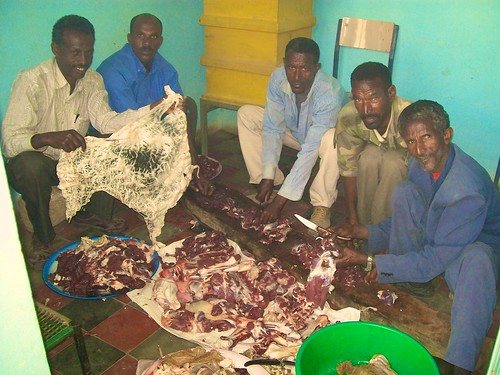 2013 - some local men prepare the goat which has just been killed as the main component of the celebratory meal. No part of the animal is wasted