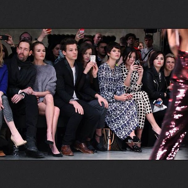 I can't help but notice that Demi Lovato is only 3 SEATS AWAY from Louis at the Top Shop fashion show! #louis#tomlinson#demi#lovato#one#direction#niall#horan#harry#styles#zayn#malik#liam#payne#directioner#lovatic#top#shop#fashion#show#this#is#a#big#deal#t