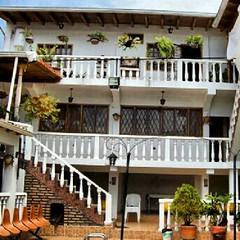 outdoor structure(0.0), pergola(0.0), condominium(0.0), hacienda(0.0), baluster(1.0), property(1.0), porch(1.0), balcony(1.0),