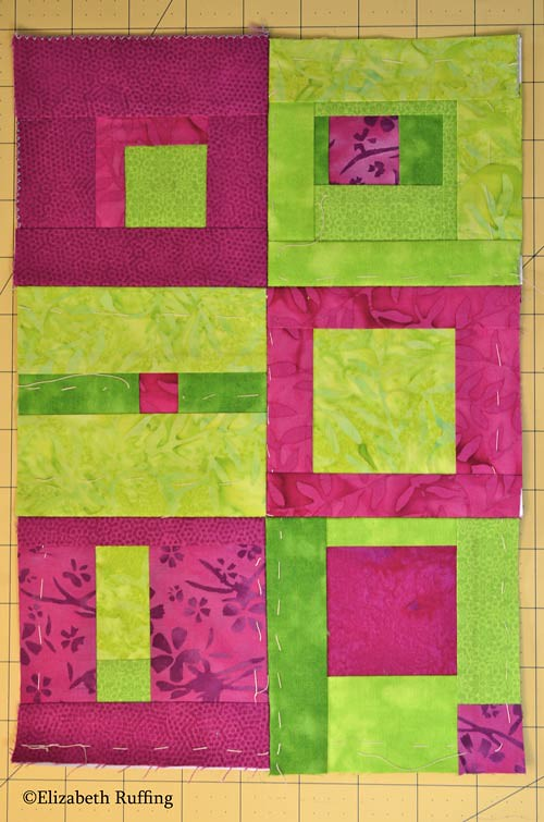 Green and magenta batik modern quilt block by Elizabeth Ruffing