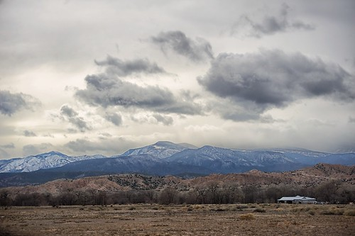 sky storm mountains newmexico field clouds farm española jemezmountains snowpeaks snowcaps ohkayowingeh