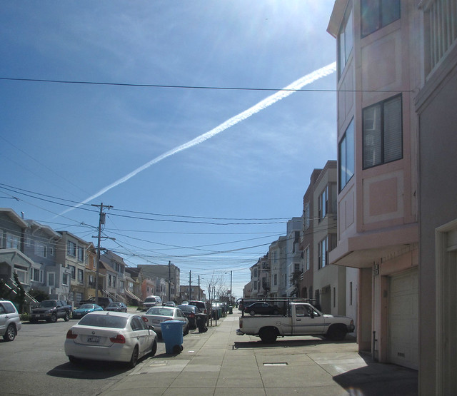 long contrail over San Francisco POV 26th ave; The Sunset (2013)