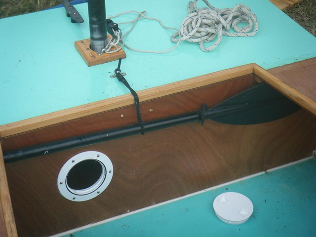 Paddle stowage on OzRacer sailboat.  Simple plywood homebuilt boat.