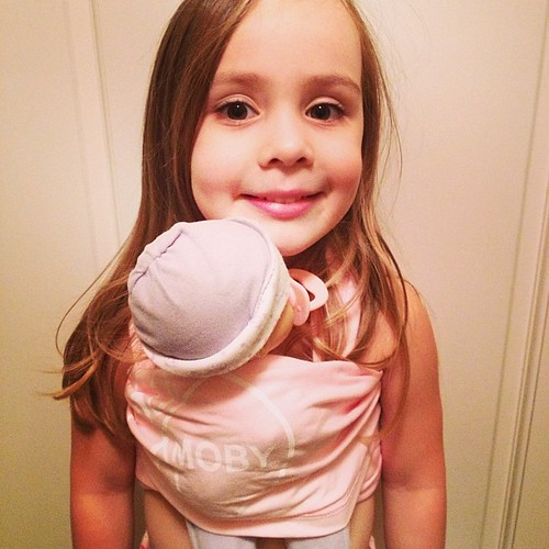 Loving her doll-sized @mobywrap & excited to wear it while Mommy wears her baby sis in hers.