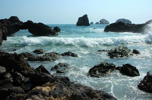 Waves rolling in, offshore islands, little rock arch, open blue sky, Pacific coast, South Mazatlan, Mexico by Wonderlane