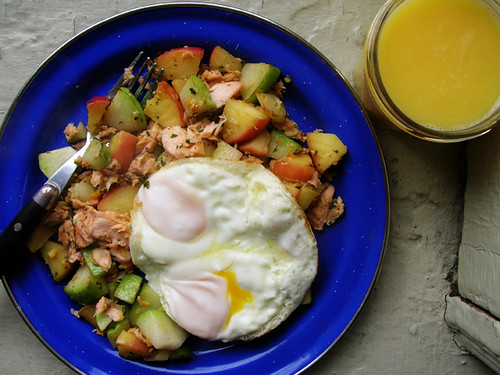 fried eggs on trout, chayote, and apple hash with OJ