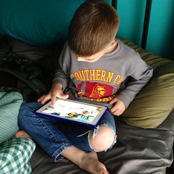 All boy. iPad gaming, and hole in the knee of his jeans. #10on10