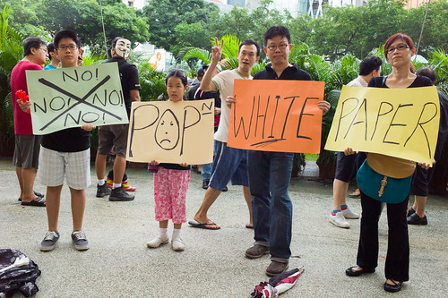A united family standing in protest at the historic mass rally, the largest bipartisan protest since Singapore's independence, with more than 5000 in attendance.